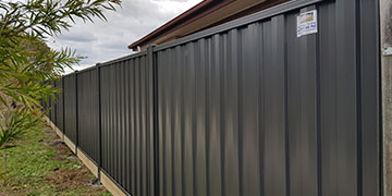 Colorbond Fence 2m High includes a Timber Sleeper underneath 200x50mm with Steel Posts, Monument Color, in Taylors Lakes
