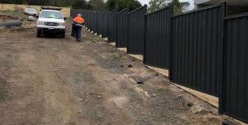 96m Colorbond Fence in South Morang with Timber Sleeper underneath 200x45mm